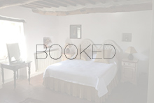 Rosina queen bedroom with the word BOOKED