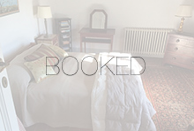 Rosina king bedroom with the word BOOKED